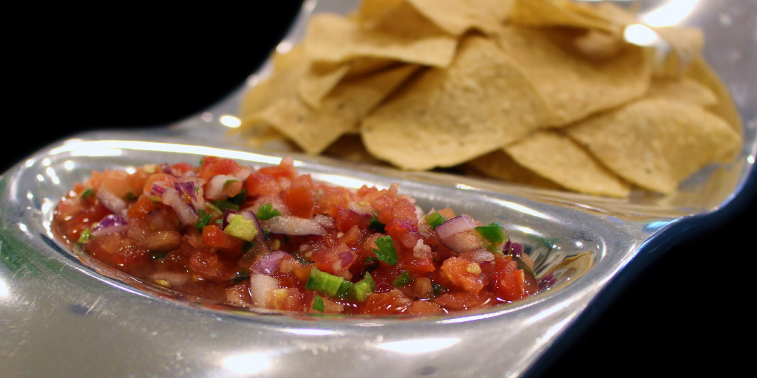 Image of Elevated Vegan Mexican Salsa Fresca on a platter with chips.